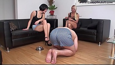 Two MILF French girl humiliate the husband of one of them by treating him like a dog.